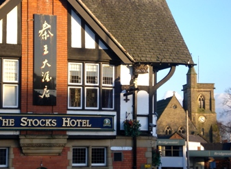 A view of the Stocks Hotel and St Pauls Church in Walkden.